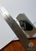 Line up your mat cutter and ruler along the guide lines you created.