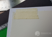 Use only a small amount of tape when taping the watercolor to the back of the mat board. This will allow you to make adjustments easier.